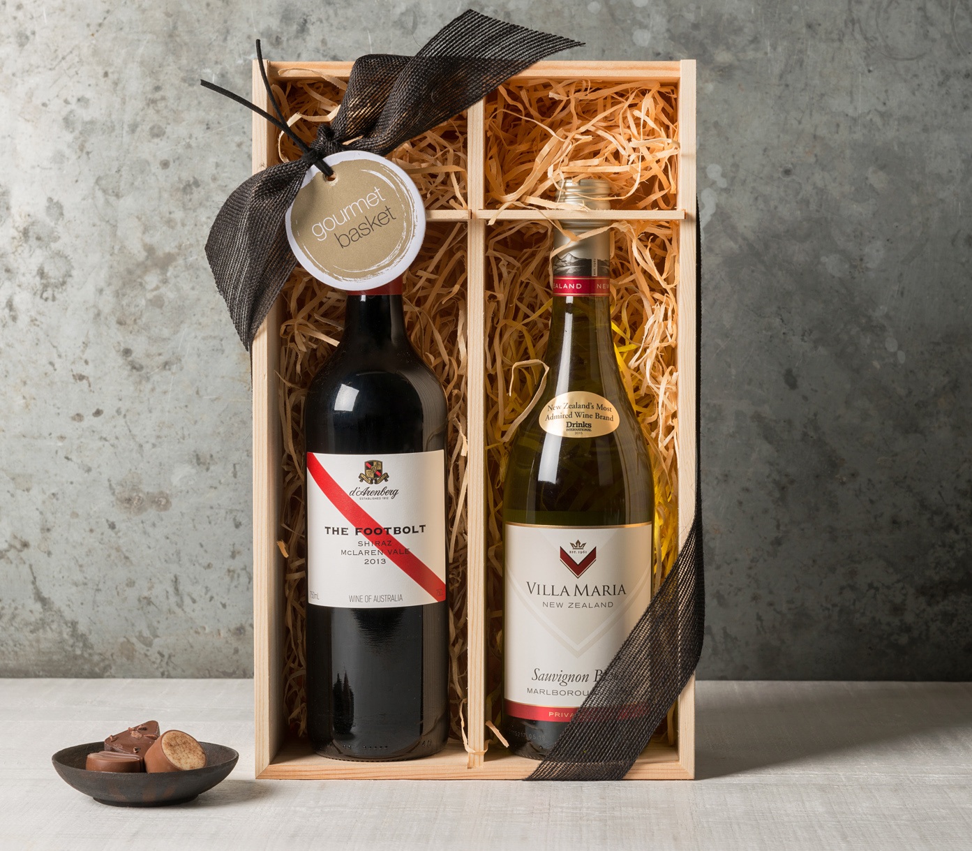 Wine gift set including red and white bottle packaged in a beautiful wooden box